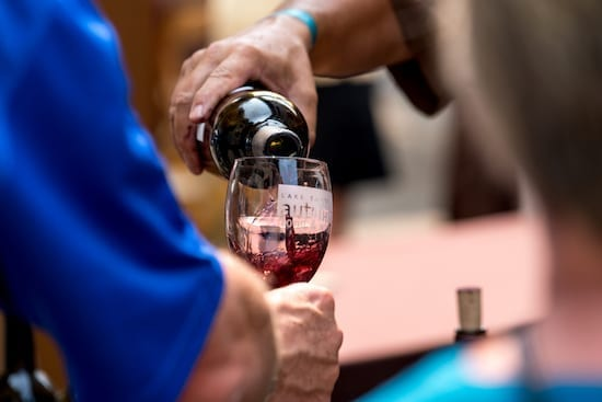 pouring wine at autumn food and wine
