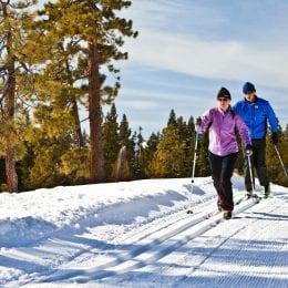 Couple skiing nice groomed cross country runs at Lake Tahoe