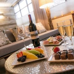 Resort at Squaw Creek dining with fruit, chocolate, and wine