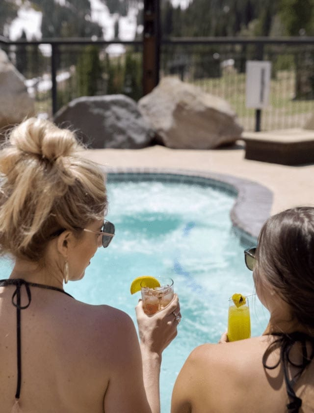 Girls by the Pool with Drinks