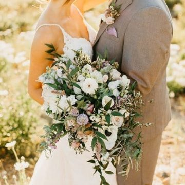 Bride and groom with large boquet in Tahoe