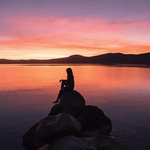Girl on rock at Lake Tahoe